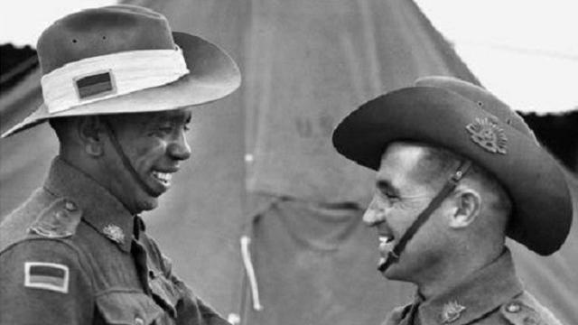 Lieutenant Reg Saunders (left) and Lieutenant Tom Derrick VC, DCM congratulate each other following their graduation from the Office Cadet Training Unit, Seymour, Victoria, 25 November 1944.  Photographer unknown. Courtesy Australian War Memorial.