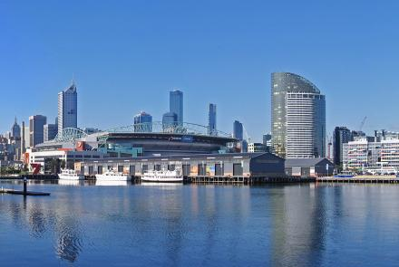 """Melbourne Docklands and the city skyline: <a href=""""http://creativecommons.org/licenses/by-sa/3.0/"""" title=""""Creative Commons Attribution-Share Alike 3.0"""">CC BY-SA 3.0</a>, <a href=""""https://commons.wikimedia.org/w/index.php?curid=993870"""">Link</a>"""