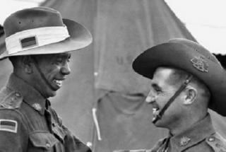 Lieutenant Reg Saunders (left) and Lieutenant Tom Derrick VC, DCM congratulate each other following their graduation from the Office Cadet Training Unit, Seymour, Victoria, 25 November 1944.  Photographer unknown. Courtesy Australian War Memorial.